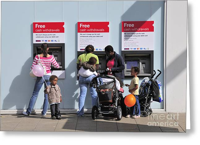 Family Budgeting At The Cash Machine Greeting Card by Andy Smy