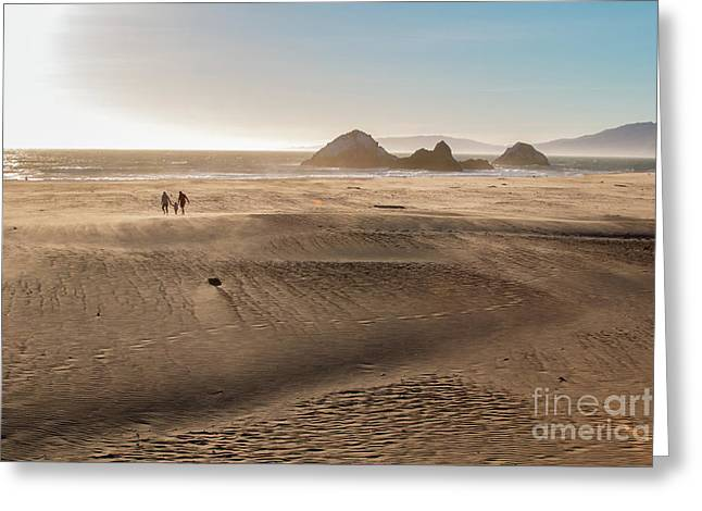 Family Walking On Sand Towards Ocean Greeting Card