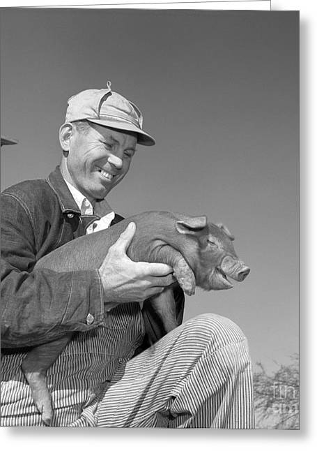 Farmer Holding Piglet, C.1950s Greeting Card by B. Taylor/ClassicStock