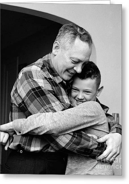 Father And Son Embracing, C.1950-60s Greeting Card by H. Armstrong Roberts/ClassicStock