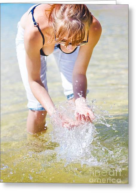 Female Traveler Playing In Shallow Water Greeting Card