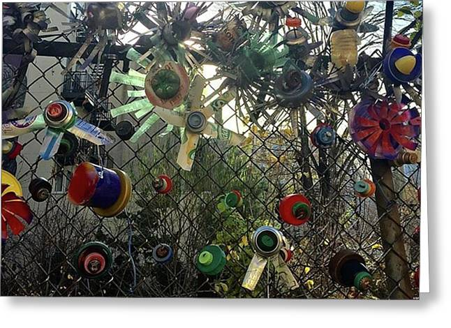 Fence Decorations Surrounding A Greeting Card by Gina Callaghan