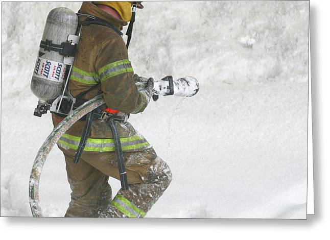 Firefighter In The Snow Greeting Card by Jack Dagley