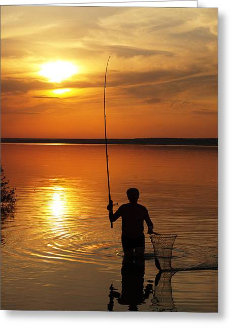 Fisherman Catches Fish By Spinning On The Lake At Sunset Greeting Card by Vladislav Romensky