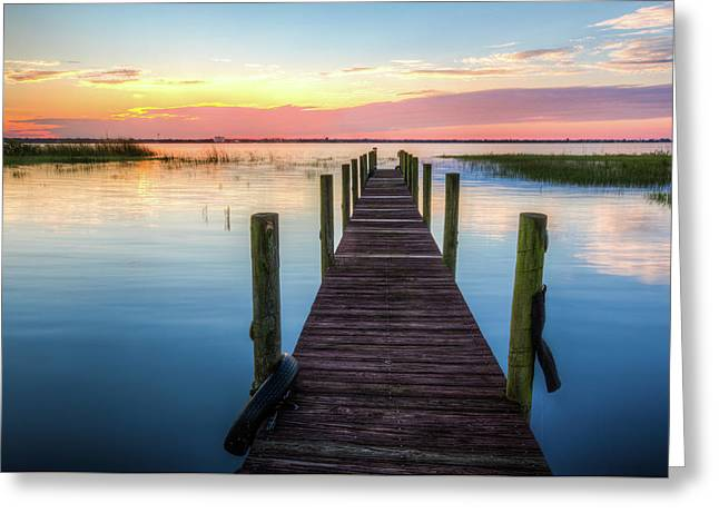 Greeting Card featuring the photograph Fishing Dock At Sunrise by Debra and Dave Vanderlaan