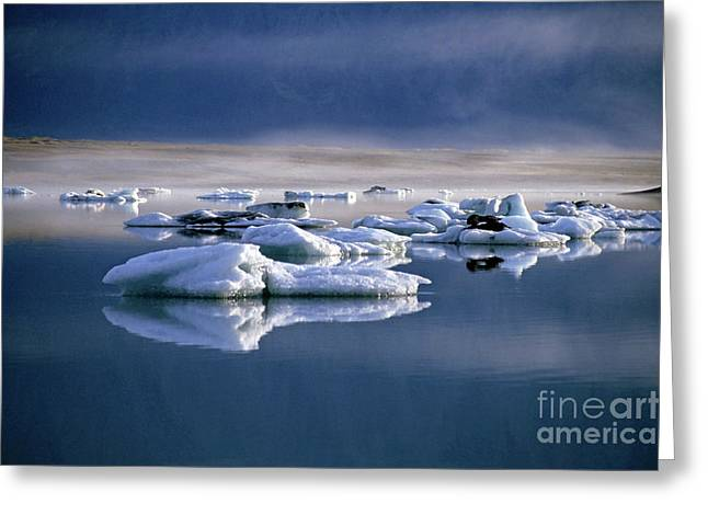Floating Icebergs Reflected In The Quiet Waters Of Jokulsarlon Greeting Card by Sami Sarkis