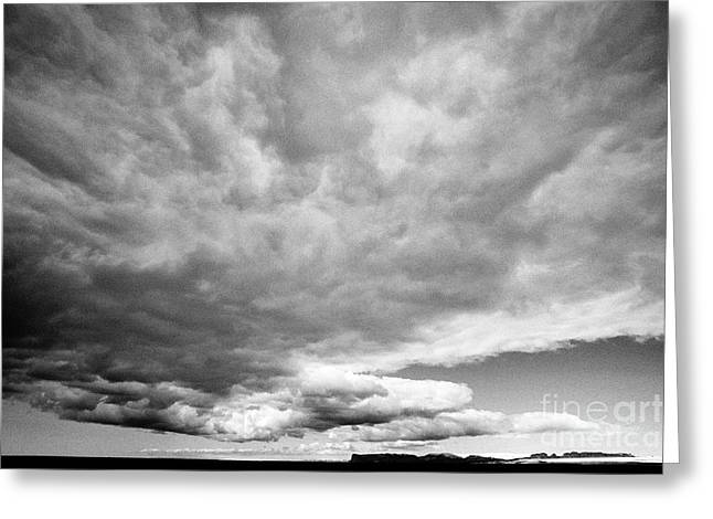 frontal cloud formation over vast volcanic ash flats Iceland Greeting Card by Joe Fox