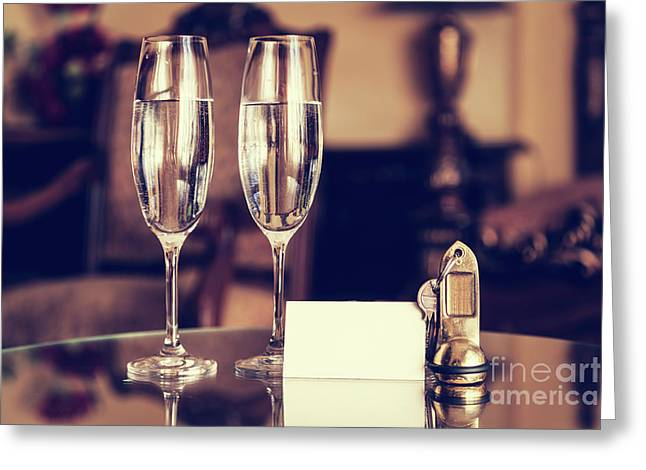 Full Champagne Glasses, Antique Keys And Blank White Card. Luxury Hotel Apartment Greeting Card by Michal Bednarek