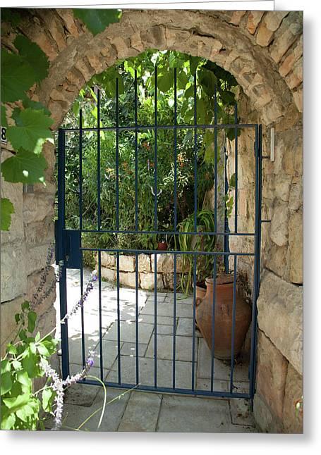 Greeting Card featuring the photograph Garden Door Entrance by Yoel Koskas
