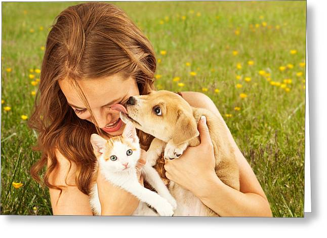 Girl In Field With Kitten And Affectionate Puppy Greeting Card by Susan Schmitz
