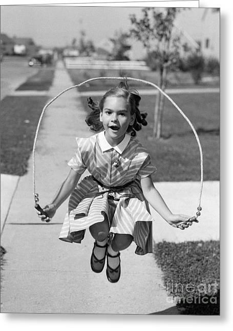 Girl Jumping Rope On Sidewalk, C.1950s Greeting Card by Debrocke/ClassicStock