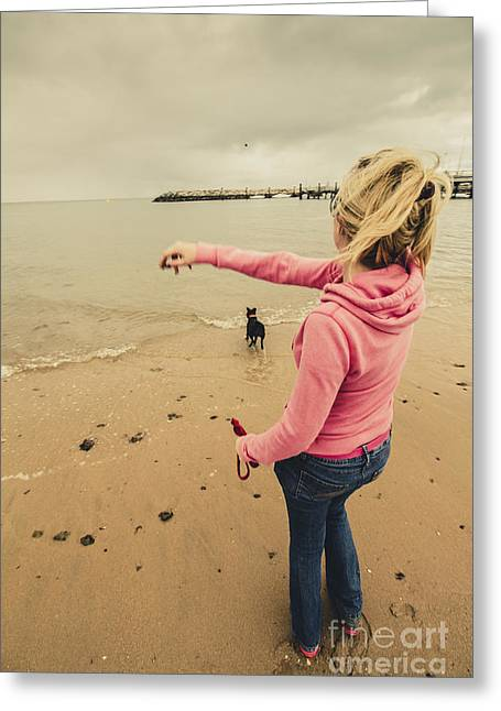 Girl Playing Fetch On Overcast Day Greeting Card by Jorgo Photography - Wall Art Gallery