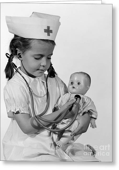 Girl Playing Nurse With Doll, C.1960s Greeting Card