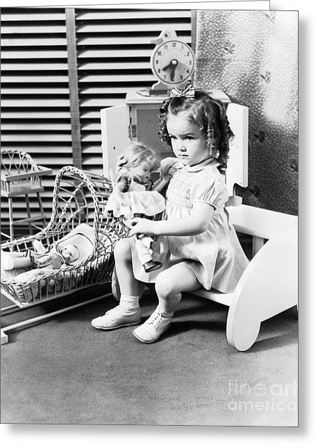 Girl Playing With Dolls, C.1930-40s Greeting Card by H. Armstrong Roberts/ClassicStock