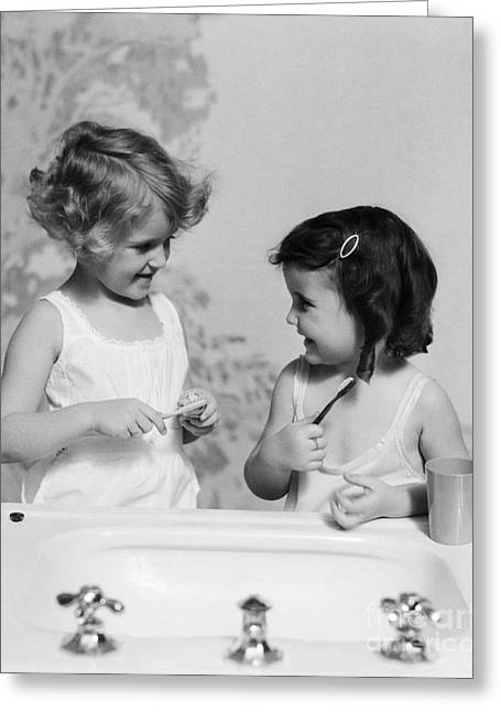 Girls At Sink With Toothbrushes, C.1930s Greeting Card by H. Armstrong Roberts/ClassicStock