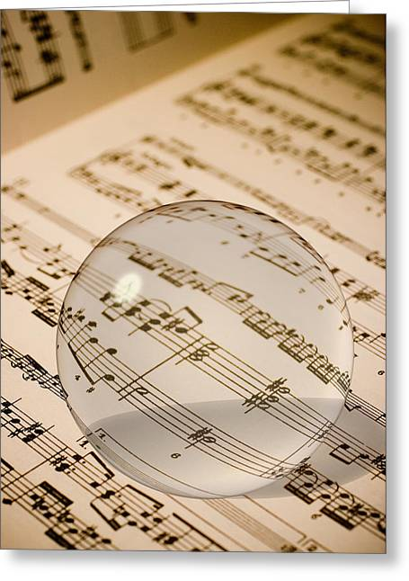 Glass Ball On Sheet Music Greeting Card by Utah Images
