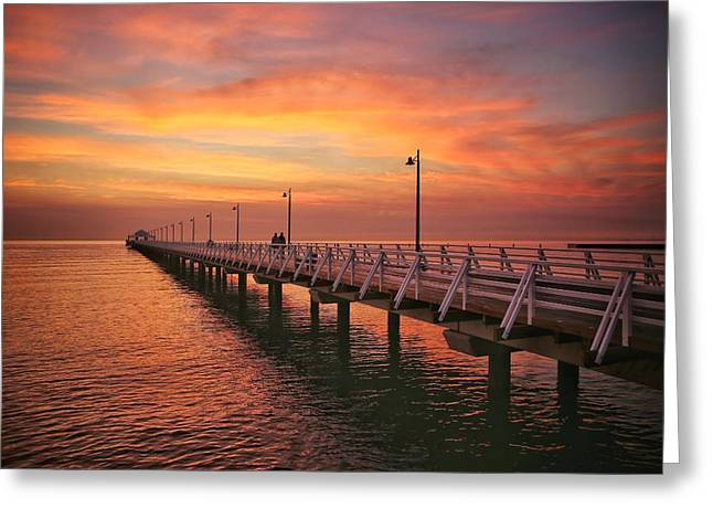 Golden Red Skies Over The Pier Greeting Card