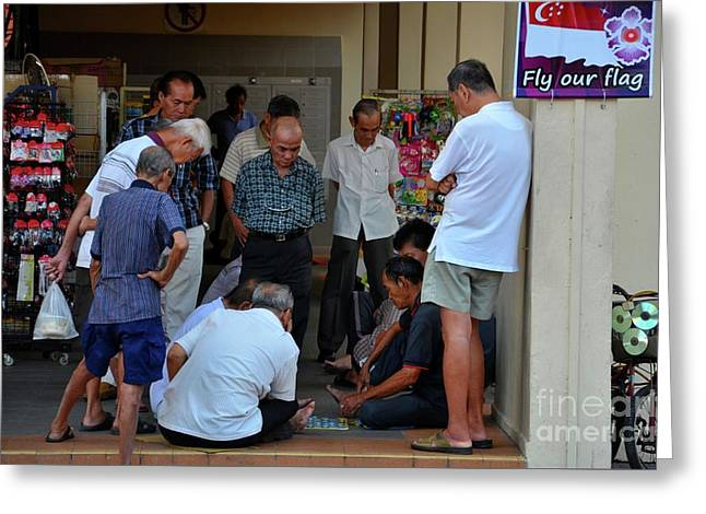 Group Of Chinese Men Watch A Game Of Checkers In Singapore Neighborhood Greeting Card by Imran Ahmed
