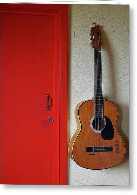 Guitar And Red Door Greeting Card