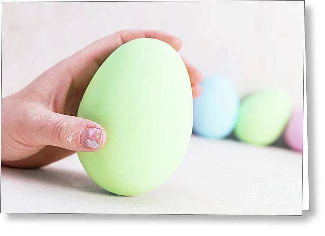 Hand Holding One Easter Egg. Greeting Card