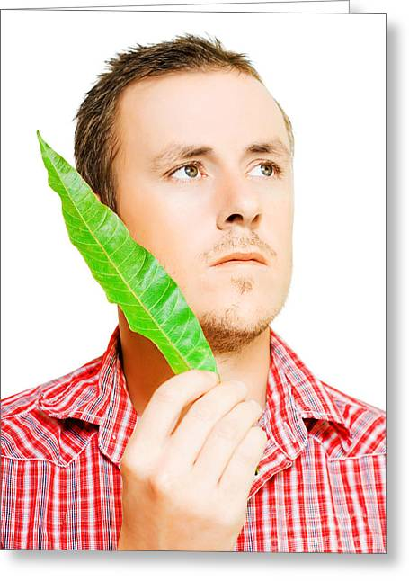 Handsome Man Holding A Green Leaf Greeting Card