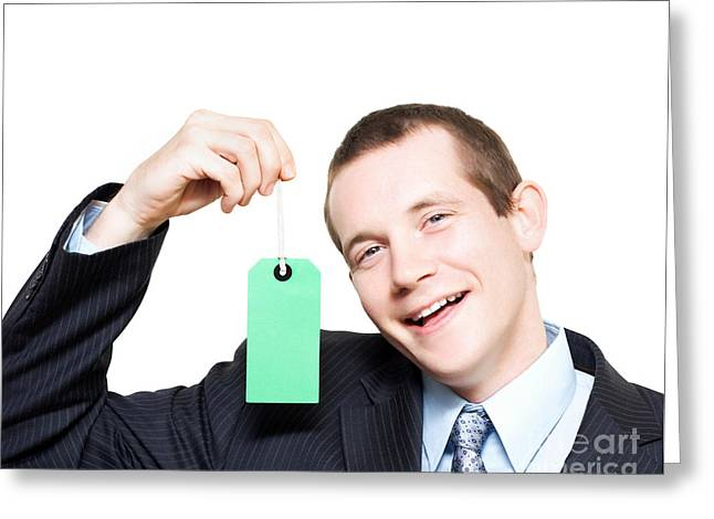 Happy Store Sales Man With Blank Price Tag Greeting Card by Jorgo Photography - Wall Art Gallery