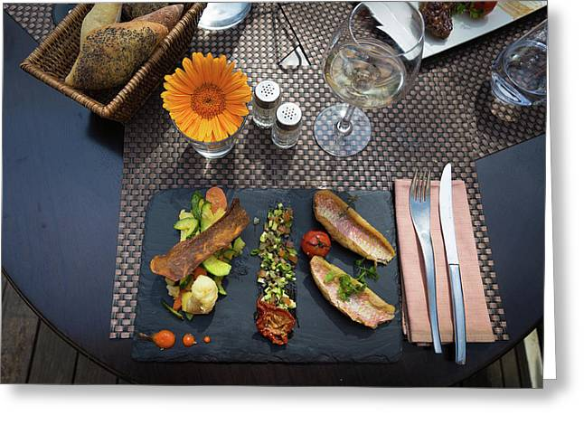 Health Fish Dish Served At A French Restaurant Greeting Card by Semmick Photo