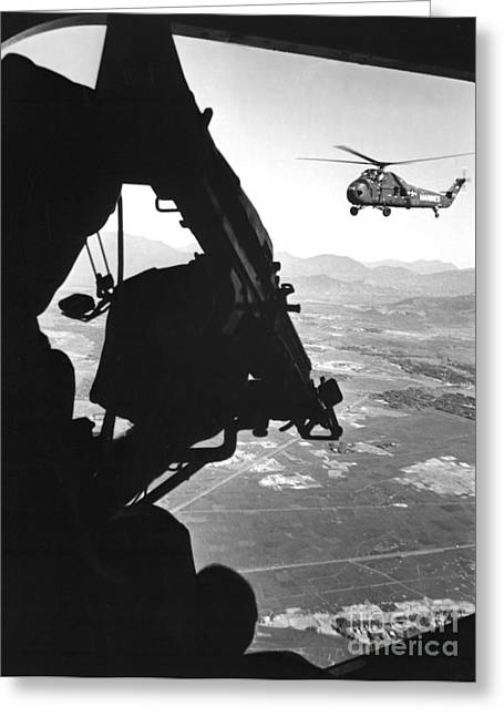 Helicopter And Soldier Approaching Greeting Card by Stocktrek Images