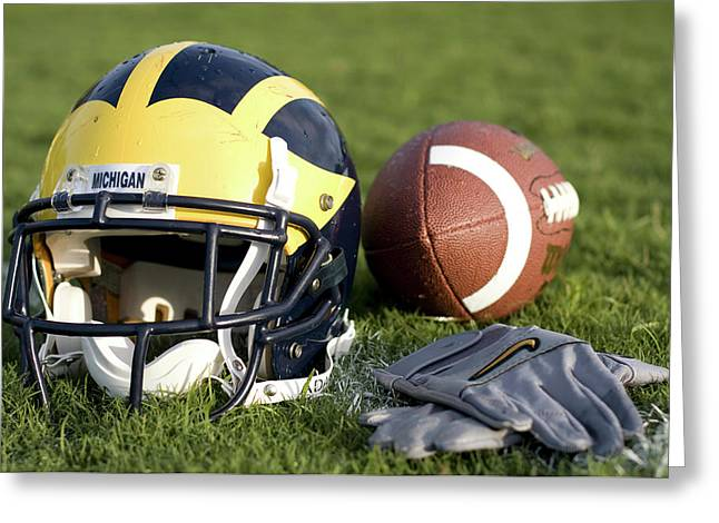 Helmet On The Field With Football And Gloves Greeting Card