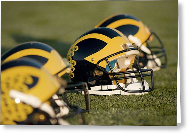 Greeting Card featuring the photograph Helmets On The Field by Michigan Helmet