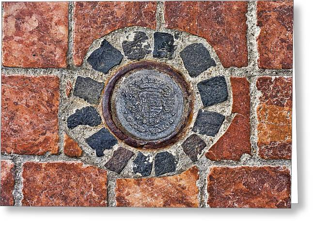 Greeting Card featuring the photograph Historic Pavement Detail With Hungarian Town Seal by Menega Sabidussi