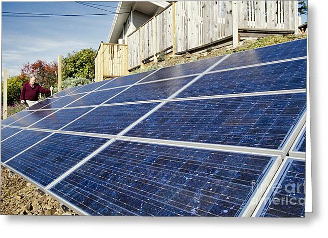 Homeowner Inspecting Solar Panels Greeting Card by Inga Spence