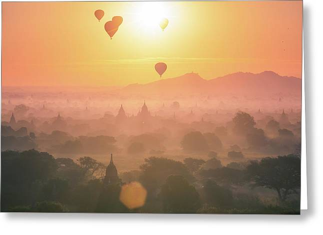 Hot Air Balloon Over Plain And Pagoda Of Bagan In Misty Morning Greeting Card by Anek Suwannaphoom