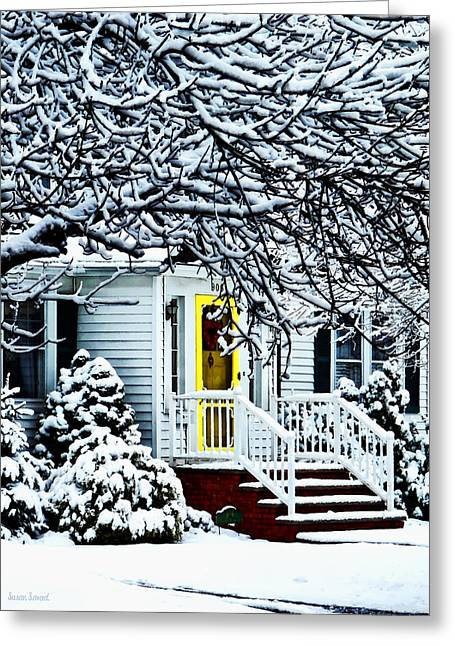 House With Yellow Door In Winter Greeting Card by Susan Savad