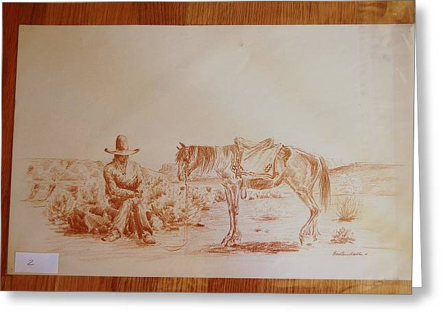 Indian Seated Next To His Horse In A Desert Greeting Card