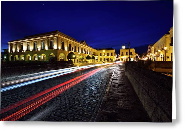 Indigo Sky And Car Lights Over Plaza Espana And Puente Nuevo Bri Greeting Card