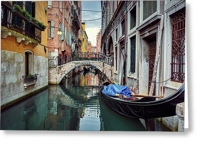 Gondola Parked On Lonely Water Canal In Venice, Italy Greeting Card