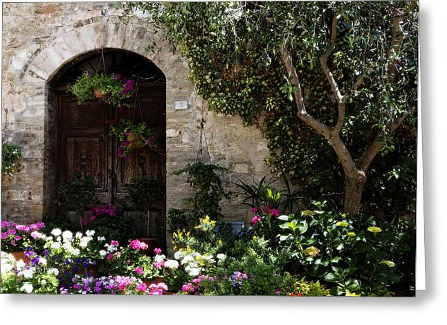 Italian Front Door Adorned With Flowers Greeting Card by Marilyn Hunt