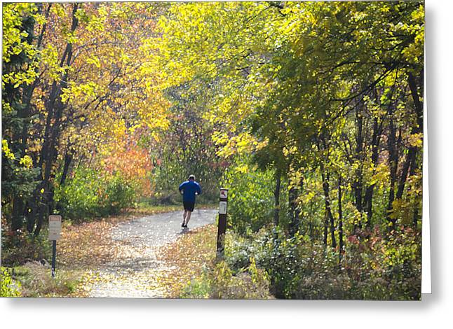 Jogger On Nature Trail In Autumn Greeting Card
