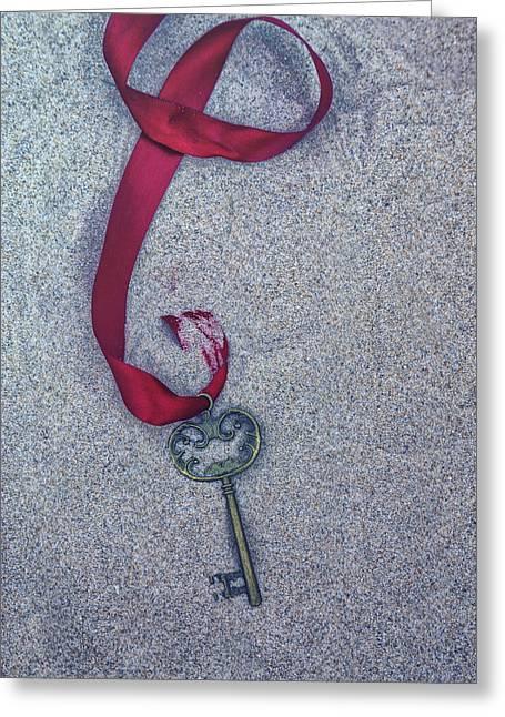 Key Buried In The Sand Greeting Card by Joana Kruse