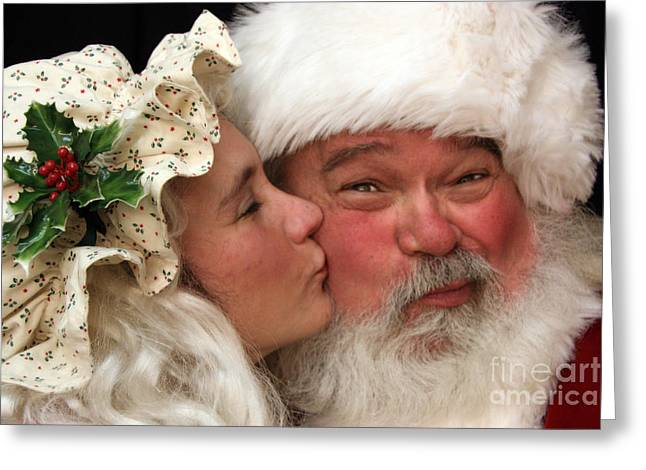 Kissing Santa Claus Greeting Card