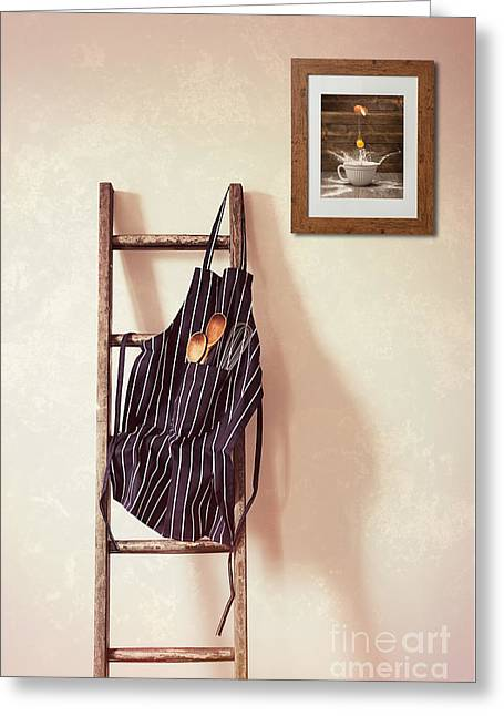Kitchen Apron Hanging On Ladder Greeting Card by Amanda Elwell
