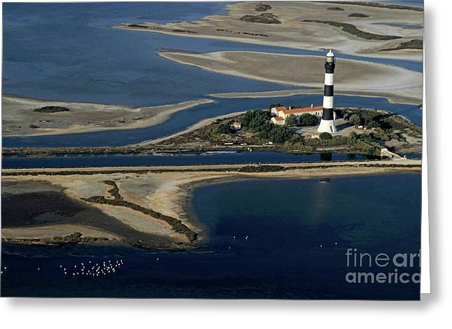 Assistance Greeting Cards - La Gacholle Lighthouse surrounded with blue sea in Camargue Greeting Card by Sami Sarkis