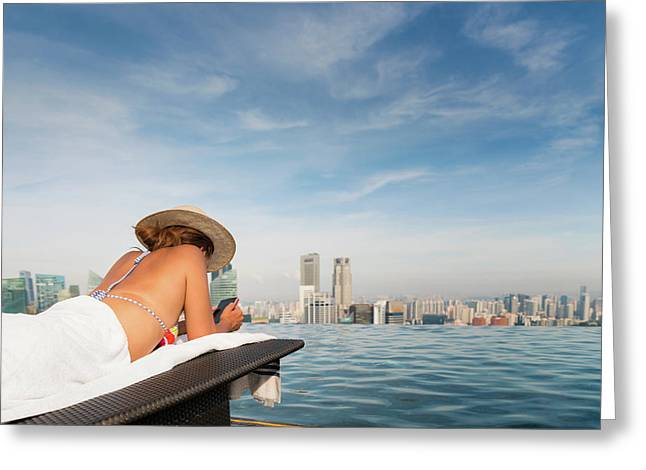 Lady In Bekiny Relax And Use Mobule Phone In Swimming Pool On Ho Greeting Card by Anek Suwannaphoom