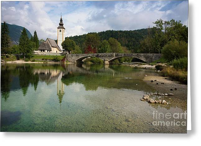 Greeting Card featuring the photograph Lake Bohinj With Church In Slovenia by IPics Photography