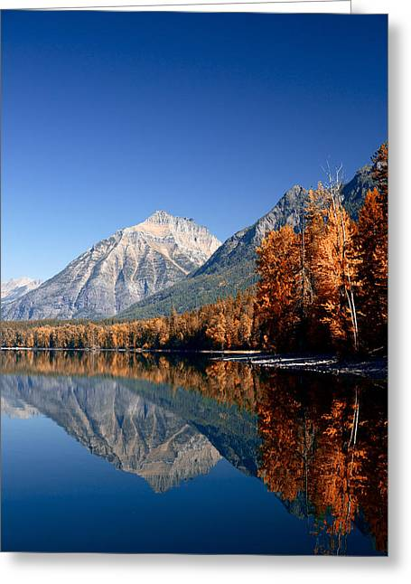 Lake Mcdonald Autumn Greeting Card by Lawrence Boothby
