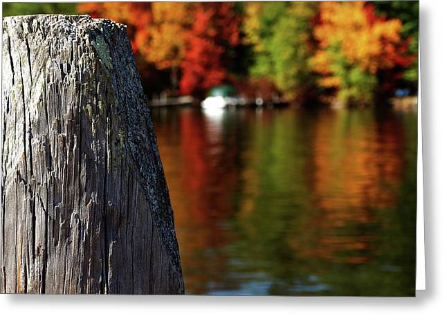 Lake Winnepesaukee Dock With Foliage In The Distance Greeting Card
