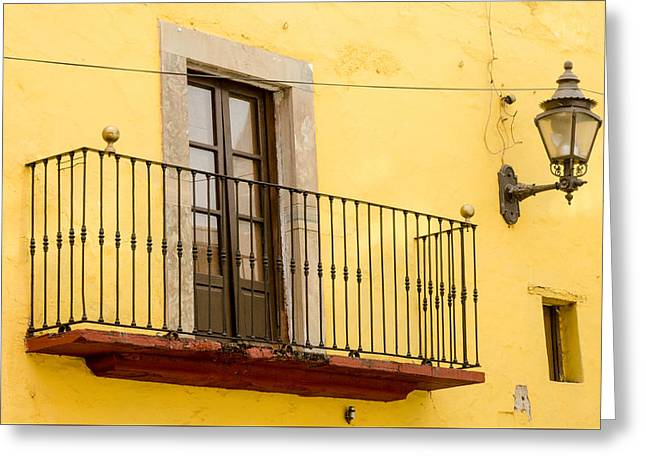 Lamp And Balcony On Yellow Stucco Wall Greeting Card by Rob Huntley
