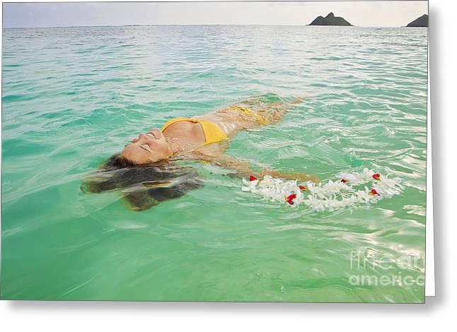 Lanikai Floating Woman Greeting Card by Tomas del Amo - Printscapes