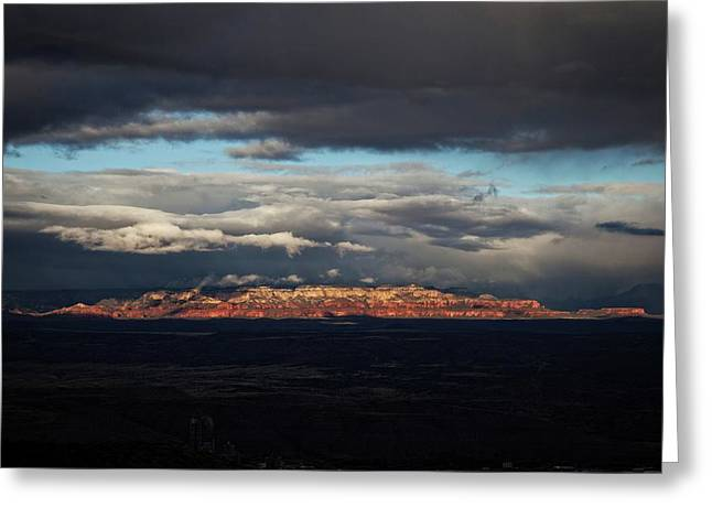 Greeting Card featuring the photograph Late Light On Red Rocks With Storm Clouds by Ron Chilston